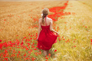 Woman in poppy field.